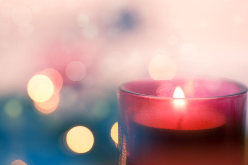 Candle with pink and blue bokeh background